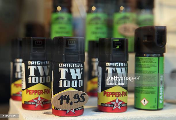 Cans of pepper spray stand on display in the shop window of a hunting and weapons store on February 25 2016 in Bremen Germany Retailers across...