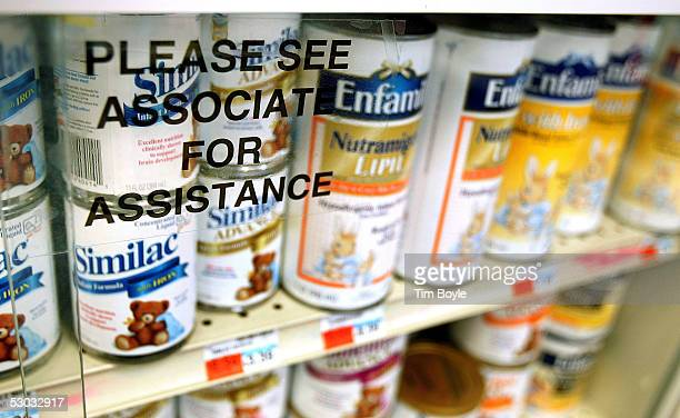 Cans of powdered baby formula are seen locked behind glass on shelves at a pharmacy June 7 2005 in Chicago Illinois Due to the possible theft of...