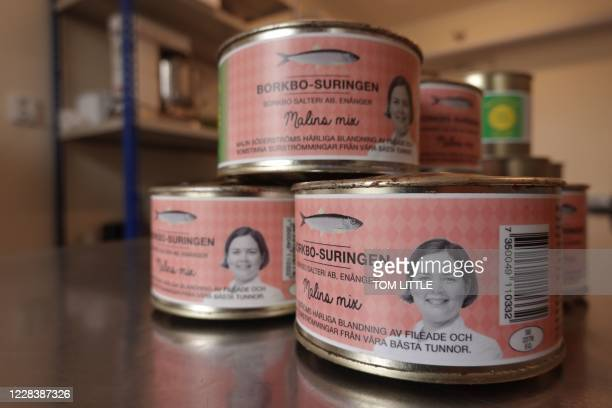 Cans of surstromming the Swedish delicacy of fermented Baltic herring embossed with the face of chef Malin Soderstrom and made near to the restaurant...