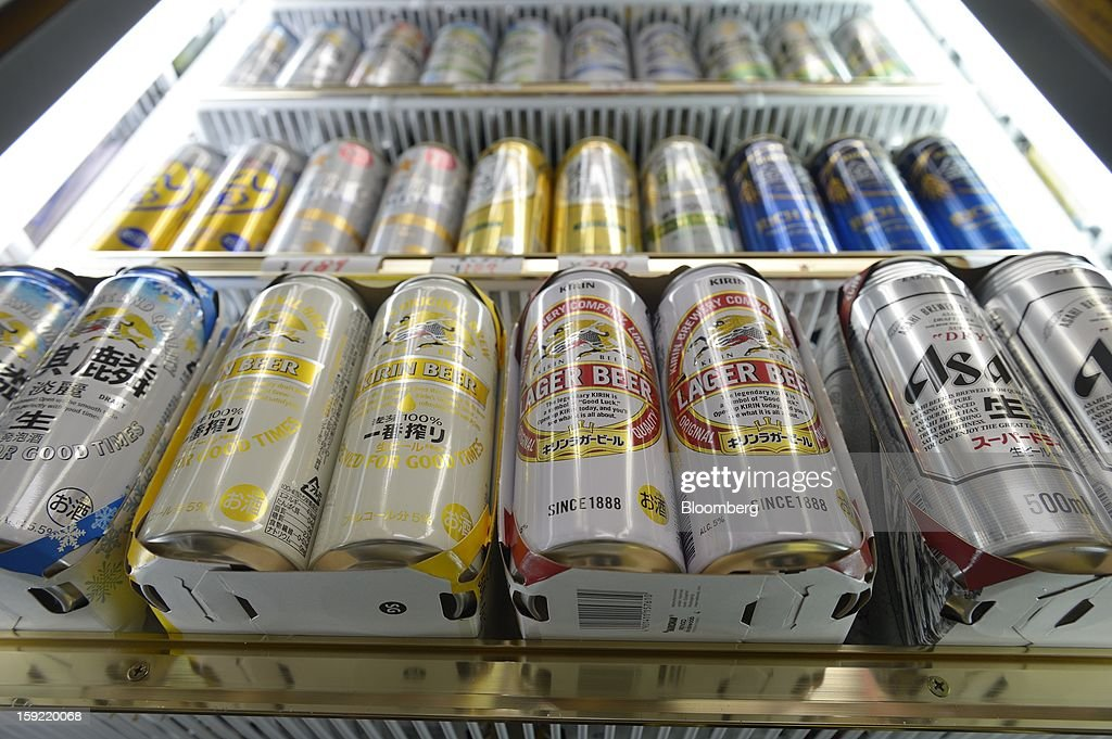 Cans of various brands of Kirin Brewery Co. beer and Asahi Breweries Ltd. Asahi Super Dry beer are displayed for sale in a liquor store in Kawasaki, Kanagawa Prefecture, Japan, on Wednesday, Jan. 9, 2013. Suntory, Kirin Holdings Co. and Asahi Group Holdings Ltd., have sought growth overseas as a declining population damps domestic demand. Photographer: Akio Kon/ Bloomberg