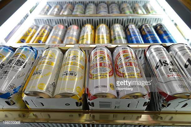 Cans of various brands of Kirin Brewery Co beer and Asahi Breweries Ltd Asahi Super Dry beer are displayed for sale in a liquor store in Kawasaki...