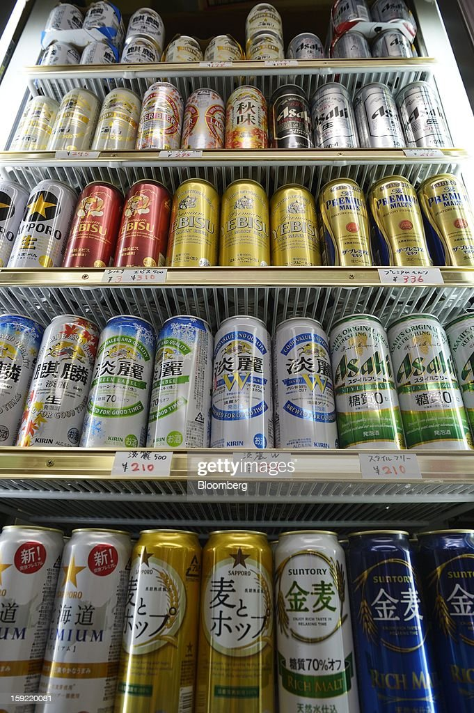 Cans of various brands of Kirin Brewery Co. beer, Asahi Breweries Ltd. Asahi Super Dry beer and Sapporo Breweries Ltd. Yebisu beer are displayed for sale in a liquor store in Kawasaki, Kanagawa Prefecture, Japan, on Wednesday, Jan. 9, 2013. Suntory, Kirin Holdings Co. and Asahi Group Holdings Ltd., have sought growth overseas as a declining population damps domestic demand. Photographer: Akio Kon/Bloomberg via Getty Images