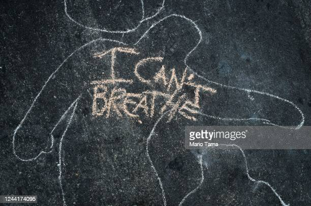 'I Can't Breathe' is scrawled on the pavement outside the District Attorney's office during a peaceful demonstration over George Floyd's death on...