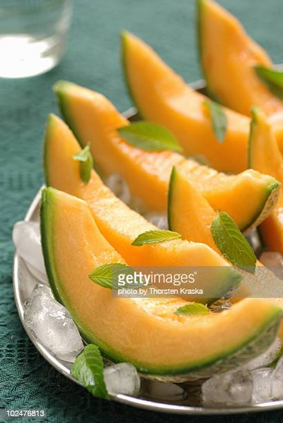 cantaloupe melon  with mint on ice - muskmelon stock pictures, royalty-free photos & images