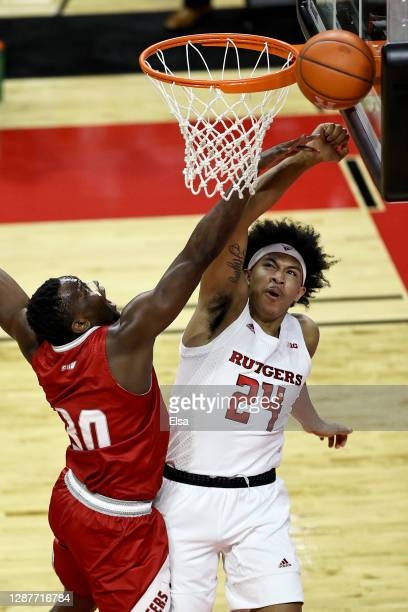 Cantavio Dutreil of the Sacred Heart Pioneers knocks the ball from Ron Harper Jr. #24 of the Rutgers Scarlet Knights in the first half during the...