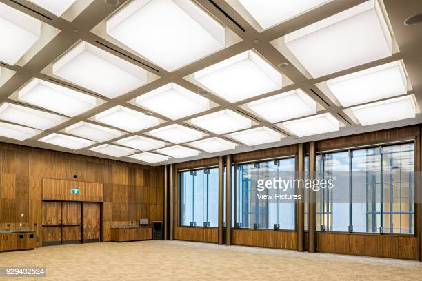 Canted light cubes add threedimentionality to the ceiling of the multipurpose room Sir John A Macdonald Building Ottawa Canada Architect Norr...