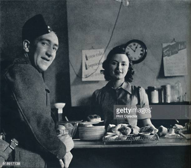 'Canteen piece' 1941 A soldier orders a cup of tea in the forces canteen at Victoria Station in 1942 The soldier pictured was the butler of a close...