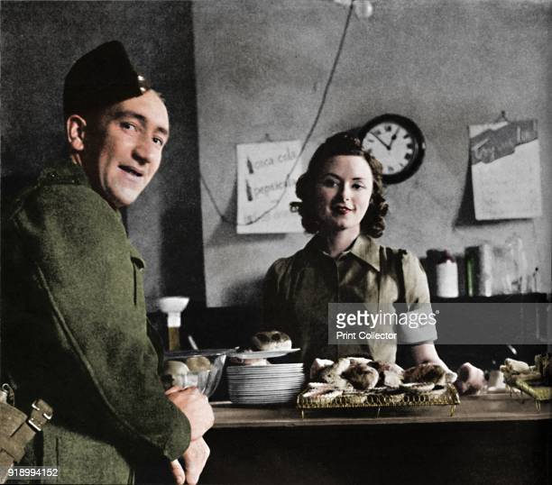 Canteen piece' 1941 A soldier orders a cup of tea in the forces canteen at Victoria Station The soldier pictured was the butler of a close friend of...
