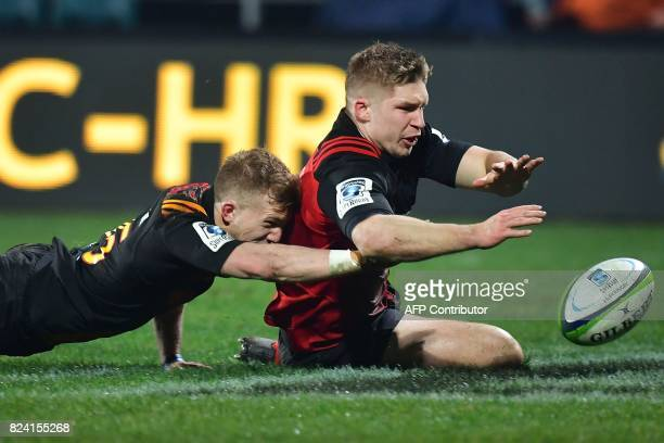 Canterbury Crusaders' Jack Goodhue fights for the ball with Waikato Chiefs' Damian McKenzie during their Super Rugby semifinal match between the...