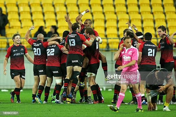 Canterbury players celebrate at the final whistle during the ITM Cup Premiership Final match between Wellington and Canterbury at Westpac Stadium on...