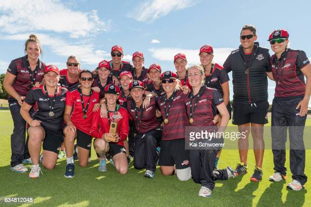 Canterbury pose with the trophy following the Women's One Day Final match between Canterbury Magicians and Auckland Hearts on February 12 2017 in...