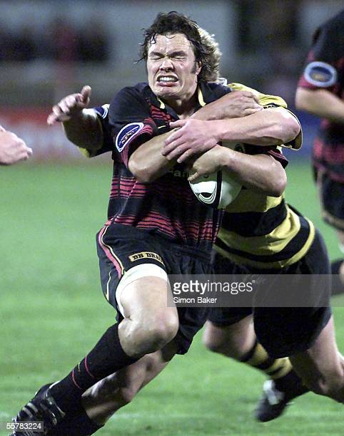 Canterbury second five Nathan Mauger is caught in the tackle by the Taranaki defence during their Ranfurly Shield and Air New Zealand first division...