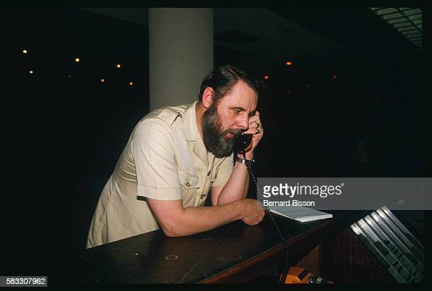 Canterbury's archbishop special hostage negotiator Terry Waite at a phone booth in the hall of the Commodore Hotel.
