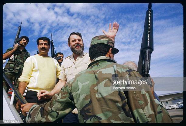 Canterbury's archbishop special hostage negotiator Terry Waite leaves Lebanon by plane guarded by soldiers.