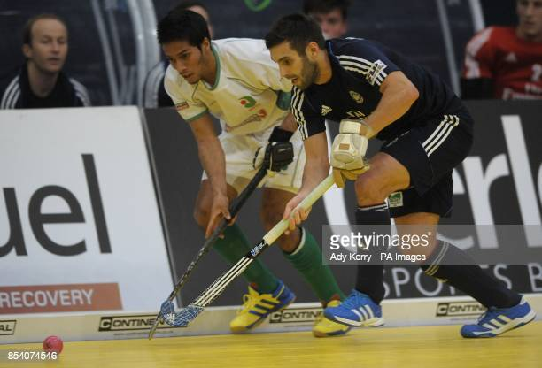 Canterbury's Devohn Teixeira challenges East Grinstead's Tim Strueven during the Maxifuel Super Sixes First semifinal at Wembley Arena London