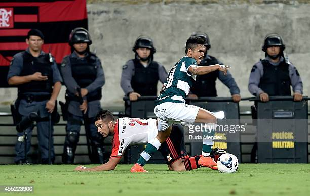 Canteros of Flamengo struggles for the ball with Erik Lima of Goias during a match between Goias and Flamengo as part of Brasileirao Series A 2014 at...