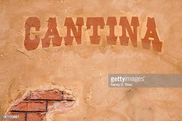 cantina sign outside bar, brick stucco wall, rustic, cinco-de-mayo - mexican beer stock pictures, royalty-free photos & images