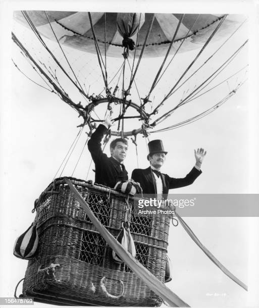 Cantinflas and David Niven waving from balloon in a scene from the film 'Around The World In Eighty Days' 1956