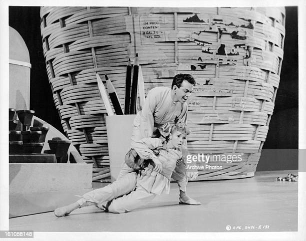 Cantinflas holds up Shirley Jones in a scene from the film 'Pepe' 1960