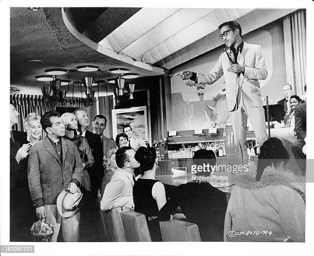 Cantinflas is sung to by Sammy Davis Jr in a scene from the film 'Pepe' 1960
