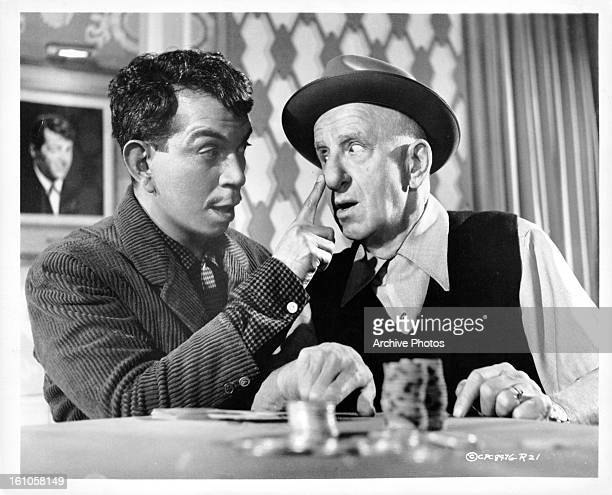 Cantinflas touches a man's nose in a scene from the film 'Pepe' 1960