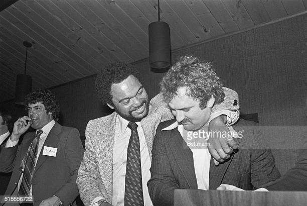 Reggie Jackson shares a laugh with Thurman Munson during a Roast in Munson's honor About 350 people attended the $200aplate dinner for the New York...