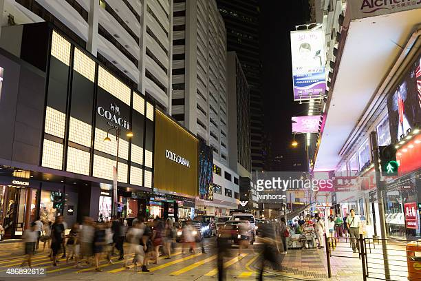 canton road in tsim sha tsui, hong kong - coach designer label stock pictures, royalty-free photos & images