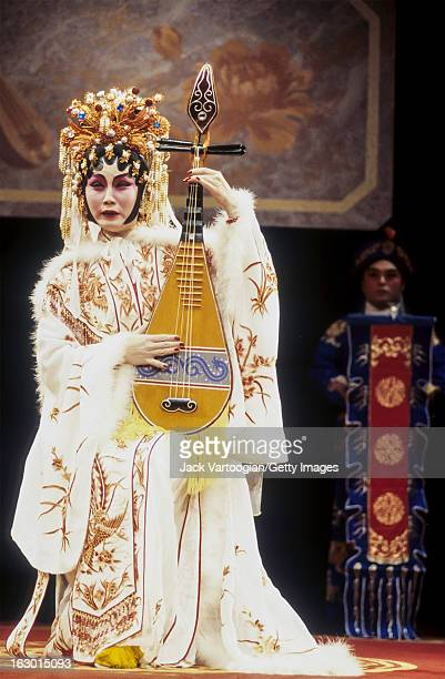Cantonese opera performer Hong Hong plays a pipa during a performance of the 'The Exile of Lady Chaochun' by the Hong Hong Cantonese Opera Company at...
