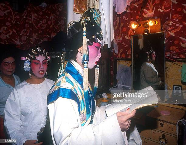 Cantonese Opera performers rehearse their lines backstage before a performance in Hong Kong Chinese opera dates back to the Tang dynasty with Emperor...