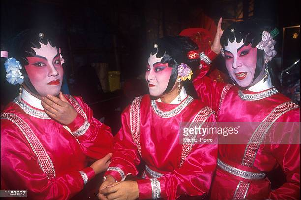 Cantonese Opera performers take a break backstage during a performance in Hong Kong Chinese opera dates back to the Tang dynasty with Emperor Ming...
