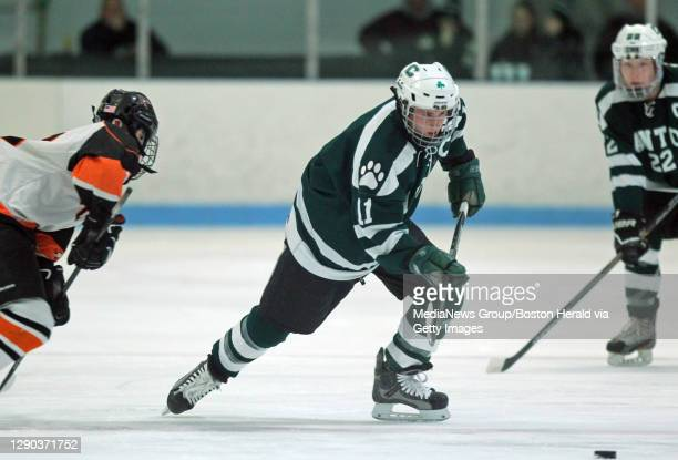 Canton's Matty Marcone heads towards the goal where he shot and scored in the first period of the game against Stoughton High at Asiaf Arena in...