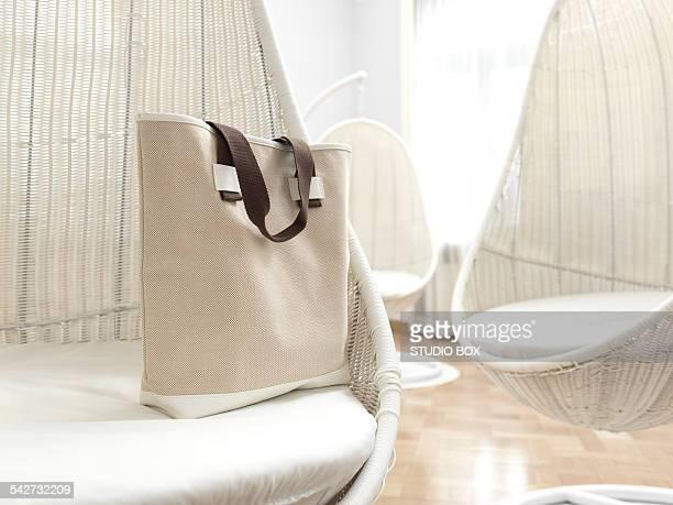 Canvas bag on rocking chairs wickerwork