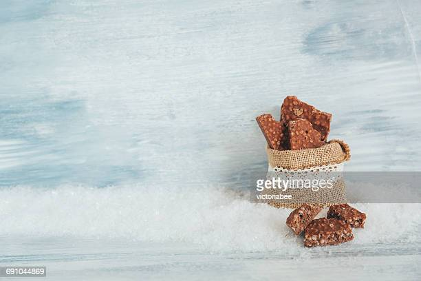 canvas bag with chocolate crispies - fake snow stock pictures, royalty-free photos & images