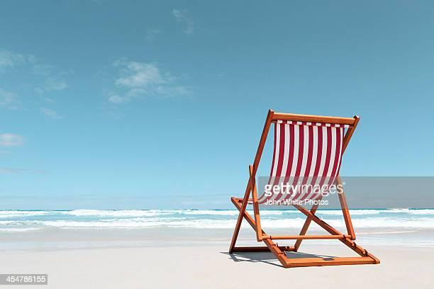 Canvas deck chair on a beach. Australia.