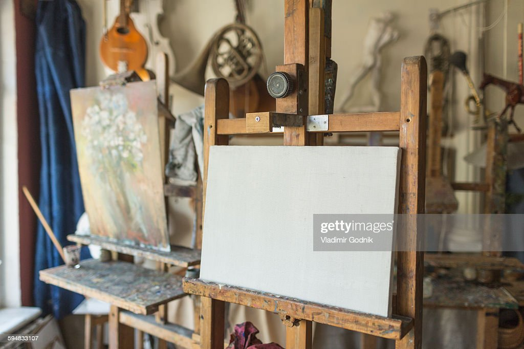 Canvas on easel in art studio : Stock Photo