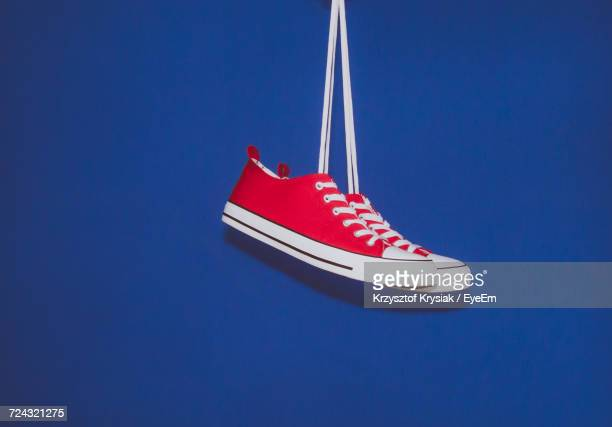 Canvas Shoes Against Blue Background