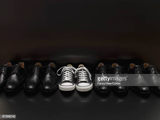 Canvas Sneakers in Row of Dress Shoes