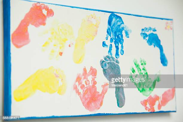 Canvas with footprints and handprints of children