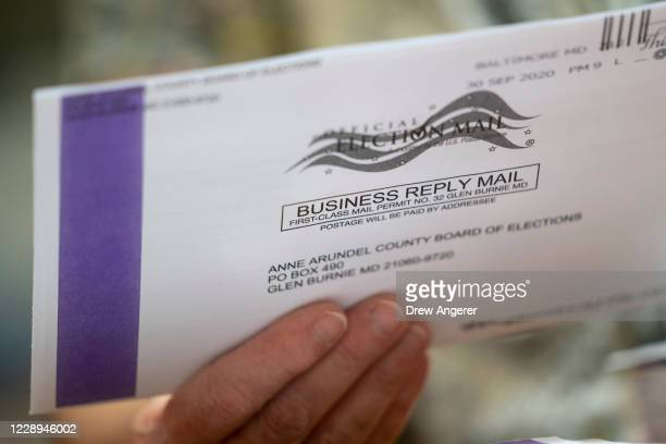 Canvasser processes mail-in ballots in a warehouse at the Anne Arundel County Board of Elections headquarters on October 7, 2020 in Glen Burnie,...