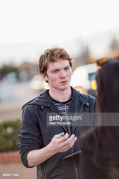 canvasser talking to woman in city - petition stock photos and pictures