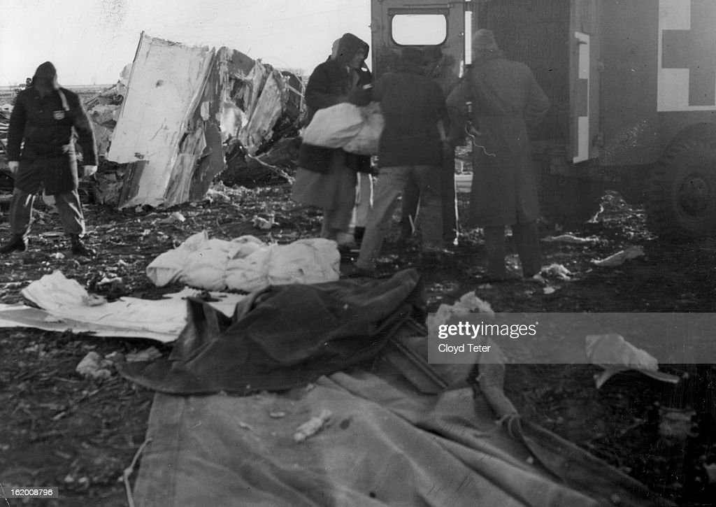 nov 2 1955 canvas shrouded bodies of crash victims are loaded into