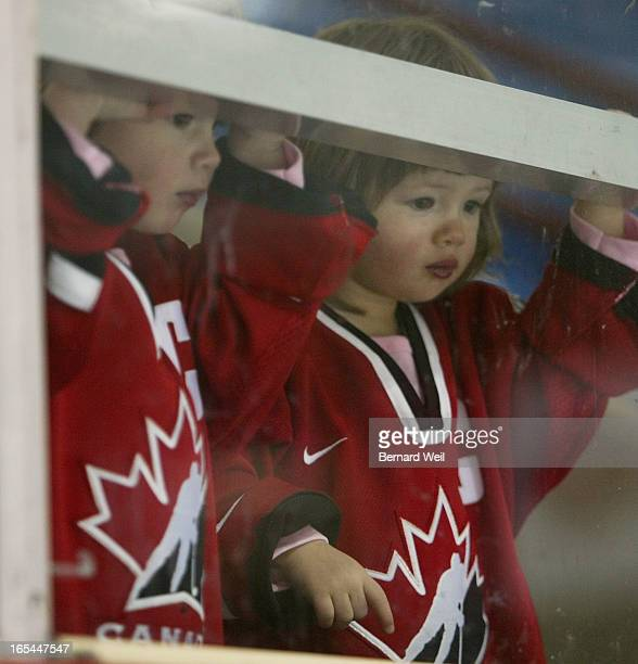 CanWmnHock_BW05_032805_Twoyearold twins Nicole and Kelly Campbell watch their aunt Cassie Campbell of the Canadian Women's National hockey team...