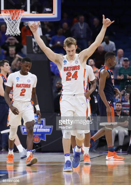 Canyon Barry of the Florida Gators celebrates their 6539 win over the Virginia Cavaliers during the second round of the 2017 NCAA Men's Basketball...