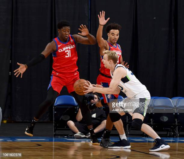 Canyon Barry of the Iowa Wolves handles the ball against Angel Delgado and Jerome Robinson of the Agua Caliente Clippers of Ontario on November 14...