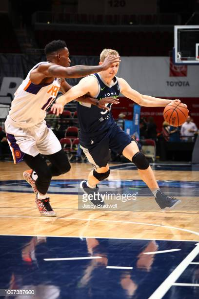 Canyon Barry of the Iowa Wolves handles the ball against Derek Cooke Jr #11 of the Northern Arizona Suns in an NBA GLeague game on December 1 2018 at...