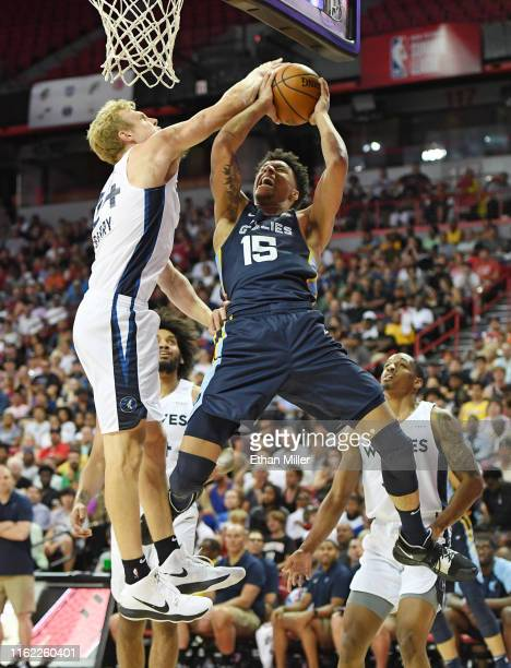 Canyon Barry of the Minnesota Timberwolves blocks a shot by Brandon Clarke of the Memphis Grizzlies during the championship game of the 2019 NBA...
