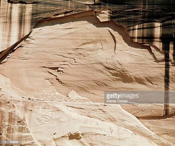 Canyon de Chelly National Monument More than 400 cliff dwellings dating from as early as 1066 were built in the canyon Rock with representation of a...