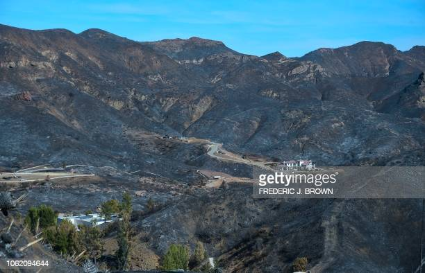A canyon home was left untouched amid the surrounding charred and blackened hillsides from the Woolsey Fire along Lobo Canyon Road in Agoura Hills...