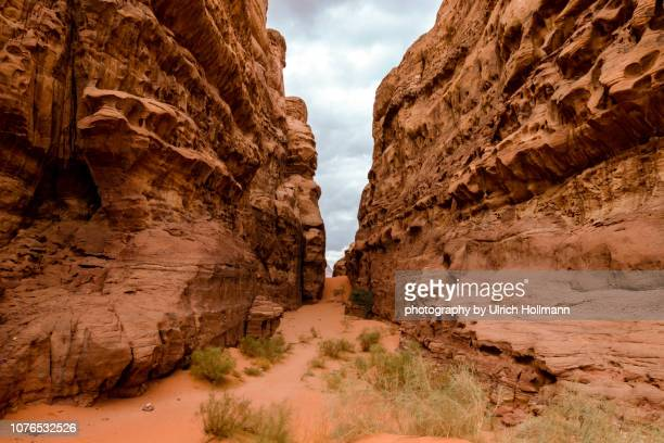 canyon in wadi rum, jordan - jordan middle east stock pictures, royalty-free photos & images