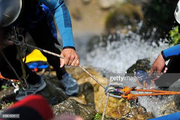 Canyoning guide fix safety ropes on Canyoning sports Enthusiast to play on waterfall during 2nd National Canyoning Randezvous oraganized by Nepal...